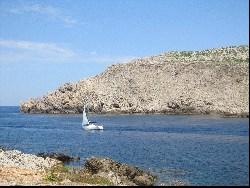Fornells sailing boat leaving harbour