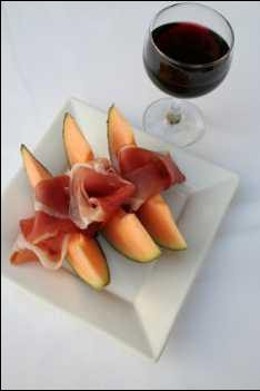 Jamon or Spanish ham with melon at breakfast or as an evening snack